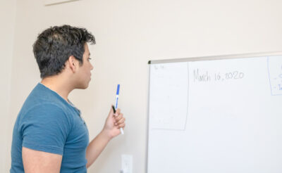 Male student looking at white board