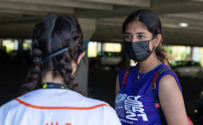 Masked girls looking at each other - Peer Mentorship