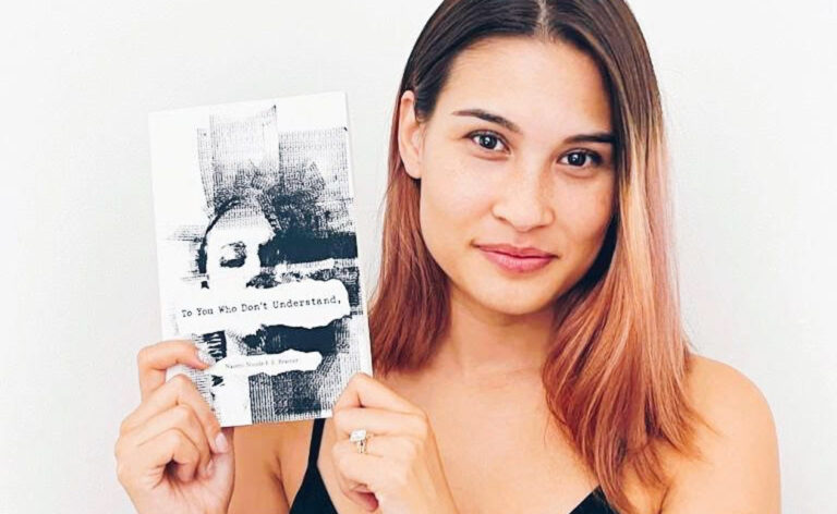 """Naomi Bramer with her book, """"Interview To You Who Don't Understand"""""""